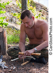 persistence - The man extracts fire in the ancient way, a...