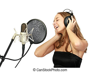 A girl sings in a studio