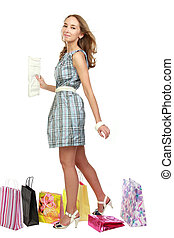 Beautiful girl with purchases.