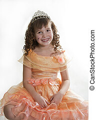Girl Princess - The girl the princess in a orange dress sits...