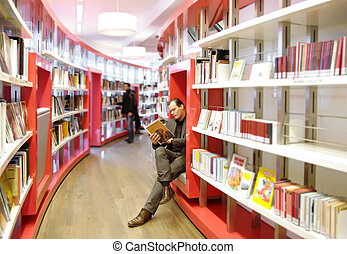 reading in library - man in interior of library, reading