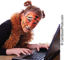 Girl in appearance a tiger with a notebook.