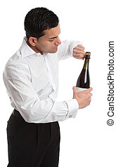 Sideview man or waiter opening bottle of champagne - A man,...