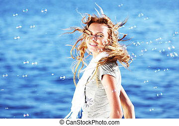 blond near sea - happy blond hair woman sea on background