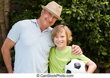 Grandfather and his grandson looking at the camera