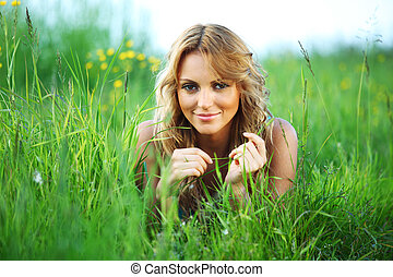 woman on the grass - woman on the green grass happy and...