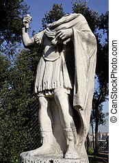 Statue without head in the Palatine gardens, in Rome.