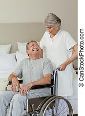 Retired man in his wheelchair with