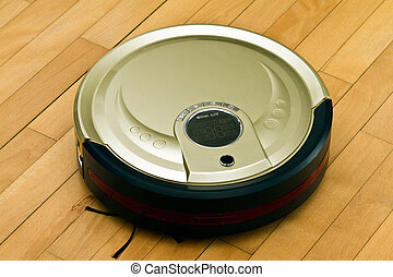 Robotic Vacuum Cleaner - A robotic vacuum cleaner on parquet