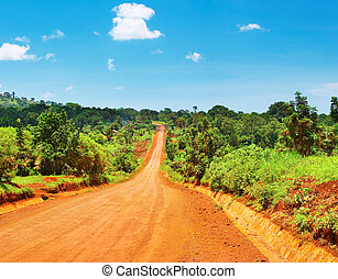 African road - African landscape with road and blue sky,...
