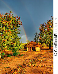 African sunset - African hut, Rainy season, Uganda