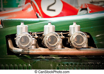 race car - carburetors on a powerful vintage race car engine