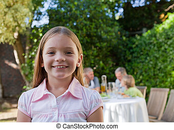 Little girl looking at the camera