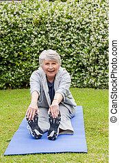Senior woman doing her streches