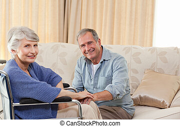 Mature couple looking at the camera