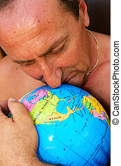 Man hugging the globe vertical picture