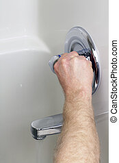 Turning on Water - An adult male arm has moved the faucet...
