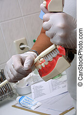 how to brush teeth - nurse is showing how to brush teeth
