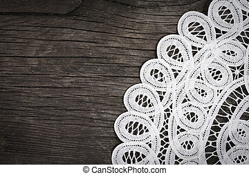 Lace on the wooden background - White lace on the wooden...
