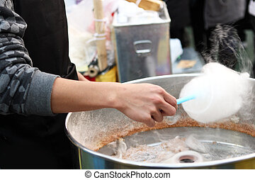 Yummy Cotton Candy - close up of man makeing cotton candy