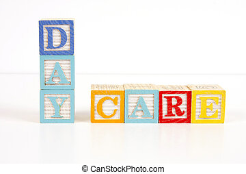 Day Care - Colorful childrens blocks spell the words day...