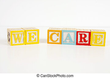 We Care - Colorful childrens blocks spell the words we care.