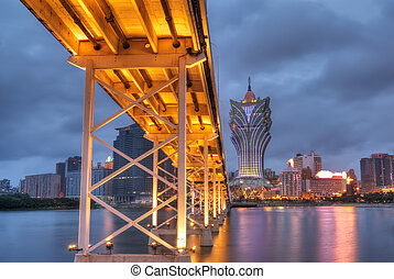 Macau cityscape of bridge and skyscraper in night in Macao,...