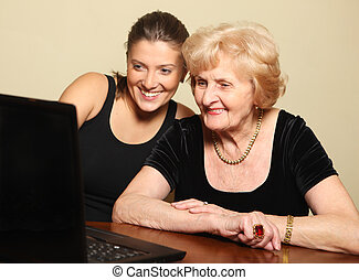 Senior lady on the computer - A picture of a senior lady and...