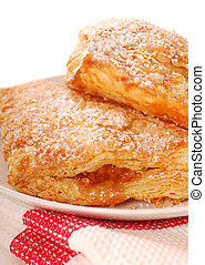 Freshly baked apple turnovers with powdered sugar