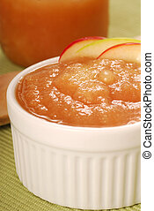 Bowl of applesauce with apple garnish