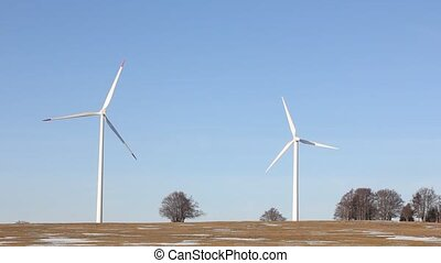 two wind mills on the field