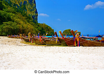 Krabi - Longtailboats tied up at a beach in Krabi