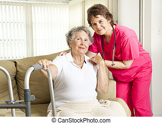 Nursing Home Care - Friendly nurse cares for an elderly...