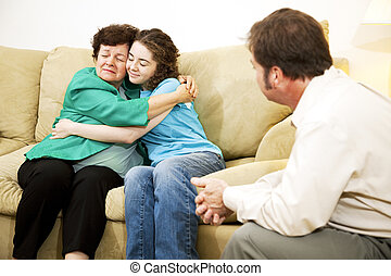 Family Conflict Resolution - Mother and daughter hugging...