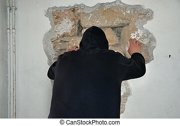 walk through walls - Man breaking down a wall with his bare...