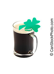 Glass of dark beer decorated with 4-leaf clover on white...