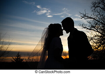 I love you - Newlywed couple, silhouetted against the...