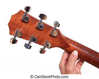 Guitar headstock - Headstock of the guitar with hands...