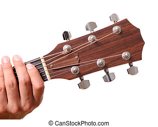 Headstock of the guitar with hands touching