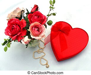 Valentine Candy, Roses, and Pearls - A red heart box of...