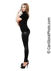 Seductive young woman in leggings. Isolated on white...