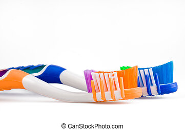 Toothbrushes - Close up of 2 toothbrushes over white...