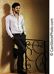 Stylish fashionable attractive young man, full lenght photo