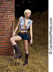 attractive cowboy girl in village - attractive cowboy...