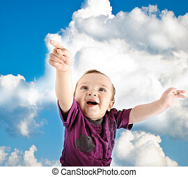 Llittle cute baby wants to fly into sky