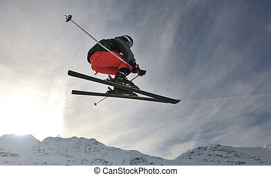 extreme freestyle ski jump with young man at mountain in...
