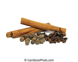 allspice, cloves and cinnamon on the white background