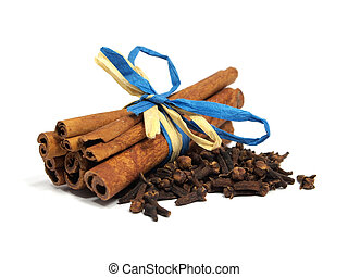 cinnamon and cloves on the white background