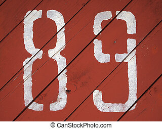 number 89 painted on a colored wood texture background...
