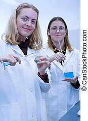 Two female researchers carrying out research in a...